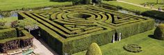 Hever Castle Maze is built from Yew. It poses the geometric challenge of a round lwithin a square. This geometric puzzle has never been solved by designers. Fisher claims he has done it at Leeds but his solution is unsatisfactory. It measures eighty feet by eighty feet. The hedges reach eight feet in height and there is almost a quarter of a mile of pathways inside. It is one of only a few traditionally designed mazes in the country and is open between April and October (weatherpermitting).