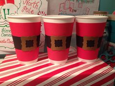 Polar Express hot cocoa cups.   I made a cone shaped template out of red card stock to cover the cup. Then I cut a slightly cone shaped template out of black card stock measuring 1 1/2 inches wide for the belt. I used the 1 3/4 inch fancy square punch to make the belt buckle out of gold card stock. Then I used a small fancy square to punch out the center.   All items were attached using hot glue. The red and black were only at glued down at the center seam.