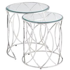"The newest starlet to feature in your living room? Our Elana Nesting Tables. Graceful and topped by beveled glass, they have a hand-forged geometric design that works well with any supporting cast of furniture. Also known as the ""it goes with anything"" factor."