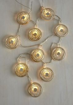 Sometimes letting your imagination run away with you pays off - say, when you wrap these string lights around your railing or tack them across your mantle! This strand of inspirational beacons makes their metallic medallion decorations gleam. Gorgeous!