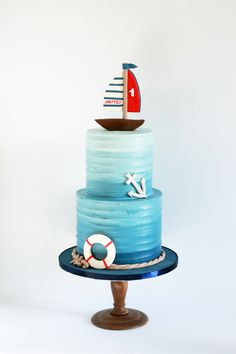 Nautical first birthday cake in blue ombre buttercream. 2019 Nautical first birthday cake in blue ombre buttercream. The post Nautical first birthday cake in blue ombre buttercream. 2019 appeared first on Birthday ideas. Nautical Birthday Cakes, Baby First Birthday Cake, Nautical Cake, Nautical Theme, Cake Baby, Sailor Cake, Boat Cake, Buttercream Birthday Cake, Baby Shower Cakes For Boys