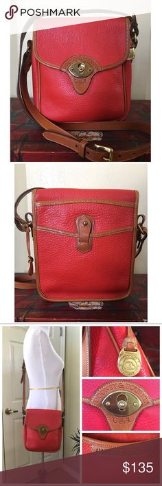 """VINTAGE DOONEY AND BOURKE CAVALRY SCOUT BAG This bag is in great vintage condition. In Gorgeous Red and British Tan. Super clean interior and exterior. There is normal wear to the hardware.  And very minor wear to the piping. This is a pre-tag era (red, white & blue) bag. It has the old D&B style brass fob. All Measurements Are APPROXIMATE:  8.0"""" L X 9.0"""" H X 2.5"""" D 17.0""""-22.0"""" adjustable strap.  1 interior zip pocket with 4 cc slots.  Closes with the D&B slide lock. Dooney & Bourke Bags…"""