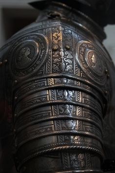 Shoulder Armor - Metropolitan Museum of Art, New York - amazing detail. I wonder if a very detailed rubber stamp or embossing and some good faux finishing could achieve this effect?