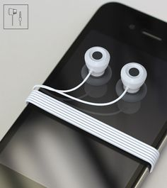 Octopus earbuds.... you can stick them on the phone so they neatly stay together and you won't lose them. Brilliant.