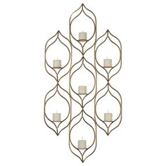 "Uttermost 04049 Rovena Seven Candle Wall Sconce. Add A Burst Of Sculptural Drama To A Room With This Gracefully Curved, Hand Forged Iron Sconce Finished In Antiqued Gold Leaf. Includes Seven 3"" X 3"" Distressed Beige Candles.Overall dimensions (Inches): 4.125D, 28.5W, 58.75H"