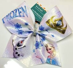 Bows by April - Frozen Elsa and Olaf Full Glitter Cheer Bow, $20.00 (http://www.bowsbyapril.com/frozen-elsa-and-olaf-full-glitter-cheer-bow/)