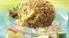 Sweet fruits pair well the spicy curry powder in a savory cheese ball coated with crunchy peanuts.