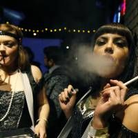 Smoke easy: Women celebrate the start of retail pot sales at a Prohibition-themed New Year's Eve party at a bar in #Denver. | AP