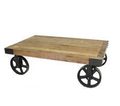 Industrial Mill Cart Coffee Table: Thick planks of reclaimed pine sit on iron pulley wheels to make one of the most unique industrial coffee tables you will ever see. Accentuated with black iron riveted corner braces the Industrial Mill Cart Coffee table looks as if it just rolled off the mill floor to your living room.