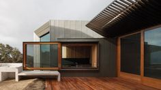 Awesome house deisgn with laminated wooden floor also glass windows and wooden windows frame