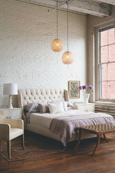 neutral bedroom, with painted brick like the simplicity and lighting of room