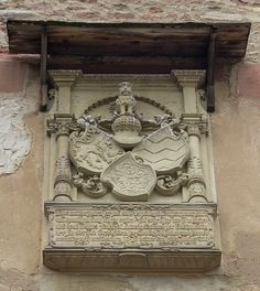 Ornamental shields adorn a crest on the Ruprechtsbau at Heidelberg Castle in Germany. The Ruprechtsbau is one of the oldest sections of the castle.