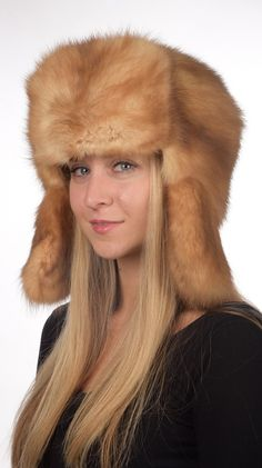 Sable fur hat is certainly among the world's most luxurious hat. Extremely soft, velvet-like and warm. This Russian style sable fur hat is available on Amifur.com online store. This hat fits both women and men. It is extremely warm, soft, trendy and very high quality. Absolutely natural  golden-champagne  color. Inner polyester lining. Each of our fur accessories is made in Italy. We ensure best quality materials.  www.amifur.com