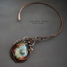 Necklace by Kuryakova Liudmila / WireDream. Copper and Porcelain Cabochon.  I love it!
