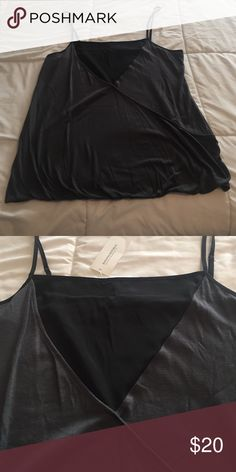 Black and gray Banana Republic tank top Black and gray Banana Republic tank top. Crosses in the front and cinches in at the waist. Brand new, never been worn! Banana Republic Tops Camisoles