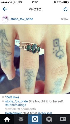 stone fox rings. 3 stone emerald (and the tattoos)