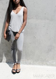Minimal style outfit   Wearing a grey metallic top + grey skinny jeans + black suede platform sandals. By Parisian and West African blogger / model Iman. Click through to find out where to find these gorgeous pieces!  http://www.manigazer.com/metallic-top/