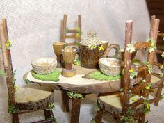 Bead goblets and acorn cup bowls - also love the furniture with its bark-on edges, nice teapot, and love the flower and moss trim and leaf placemats