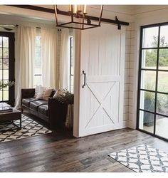 Sliding barn door design ideas for your home with mirror, window. Interior and exterior sliding barn door for your bathroom, bedroom, closet, living room. Modern Farmhouse, Farmhouse Style, Farmhouse Decor, Farmhouse Rugs, Farmhouse Bathrooms, Farmhouse Flooring, Fresh Farmhouse, Farmhouse Front, Modern Barn