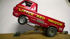 http://www.ebay.com/itm/Dodge-Little-Red-Wagon-Wheelstander-Slot-Car-Cox-Revell-Mila-Miglia-Weldun-/261716025842?pt=Slot_Cars