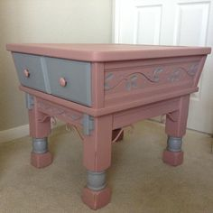 A very unique table by the Mersman Furniture Company. I hand painted it using pink and gray chalk style paint and finished it with clear and dark wax. The metal parts were painted and finished with clear Polycrylic. Mary's Garden of Refinished Treasures www.facebook.com