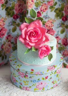 Vintage rose cake.  Creative use of a tin as a stand!