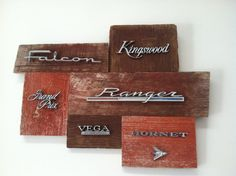 SOLD!! Reclaimed wood art adorned with vintage car/truck emblems.  Emblems include:  Ford Falcon, Kingswood, Grand Prix, Ranger,  Chevy Vega and AMC Hornet.   Chuck takes custom requests.  All Ford, all chevy or all Dodge requests can be accommodated.