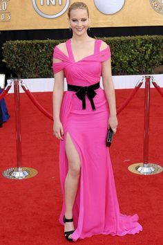 Jennifer Lawrences Style File. At the SAG Awards in a hot pink Oscar de la Renta pre-autumn/winter 2011-12 gown.