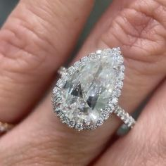 This incredible 2.80ct Pear Shaped Diamond Engagement Ring is truly one-of-a-kind. It sparkles like no other and has insane finger coverage. Give us a call or come see us at our showroom to design your dream engagement ring! Celebrity Engagement Rings, Pear Shaped Engagement Rings, Dream Engagement Rings, Designer Engagement Rings, Uncut Diamond, Halo Diamond, Diamond Rings, Diamond Anniversary Rings, Diamond Wedding Bands