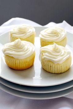 Cake-like Limoncello cupcakes topped with cream cheese frosting infused with more Limoncello.