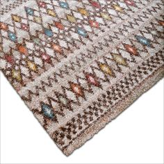 The Granada Multi Triangles Area Rug Is A Fashionable Piece Made In Belgium