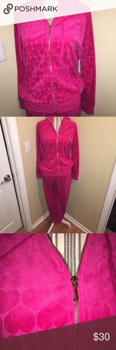 Juicy Couture Hot Pink Velour Heart Tracksuit Juicy Couture Hot Pink Heart Prink Velour Tracksuit. Jacket and pant has a heart print all over. Jacket zipper has gold tone 'J' and by left pocket gold tone 'JC' letter logo. Pants have a banded ankle. Gently used/smoke free home. Juicy Couture Pants Track Pants & Joggers