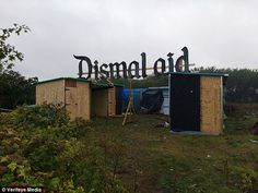 Using timber from the Dismaland 'bemusement park', shelters have started to appear in 'Dismalaid'