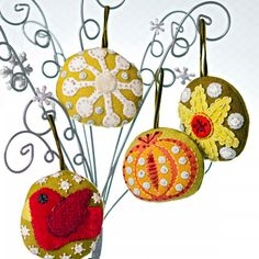 """Seasonal Stitches  Increase your hand-embroidery know-how as you embellish holiday motifs on a  set of stuffed wool ornaments.Designer: Sue Spargo of Sue Spargo Folk-Art Quilts Finished ornaments: approximately 2-1⁄2×3"""" Quantities are for 100% felted wool and 100% silk velvet fabrics."""