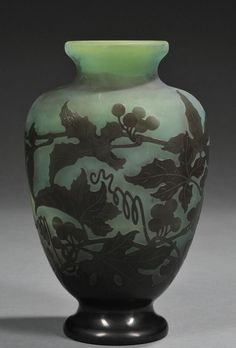 Émile Gallé | Gallé Cameo Glass Vase, Art glass, Flared rim on vasiform cameo decorated in dark green with grapes, vines, and leaves in dark green.