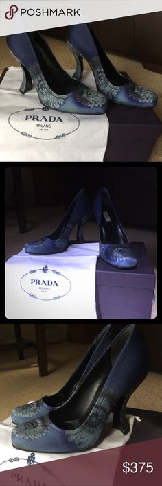 *ON SALE* Prada Calzature Donna Bleu Rosina Heels Authentic Prada Calzature Donna Twill Rosoni Bleu High Heel Pumps Size: 37 Color: Midnight blue with softer blue hue floral pattern Fabric Content: Satin, Iole: Leather, Outsole: Leather Round toe and covered heel. Comes in the original box with dust bag. Iole Length: 9.50, Iole Width: 3.00, Heel Height: 4.00, Total Height: 6.50. Pre-owned, very gently used. Excellent condition. No sign of wear on the ioles. Light scuff marks on the…