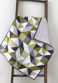grey and green geometric quilt. I wouldn't have thought to put those colors together, but they are very fresh and modern.