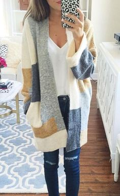 Stylish yet comfy, this beige cardigan sweater is perfect for this season. The most eye-catching is its unique color block design. In these chilly mornings and nights, slip into this wonderful piece!