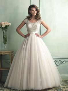 This English net ballgown features a delicate cap sleeve and gorgeously beaded bodice. From Allure Bridal.