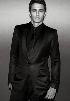 James Franco in an all black suit.