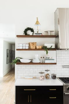 Black, white, wood, and touches of gold kitchen