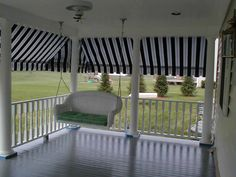 Porch awnings add color and dimension to a house, not to mention a dash of privacy.