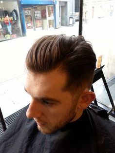 Ben, low faded and swept undercut side parting, with weight build-up on the crown