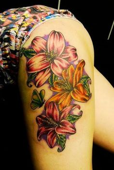Beautiful Lily Flower tattoo design on thigh of a girl.