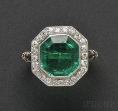Art Deco Platinum, Emerald, and Diamond Ring, T.B. Starr, bezel-set with an emerald-cut emerald measuring approx. 9.70 x 9.20 x 4.80 mm, framed by old European-cut diamonds, elaborate heart-shape gallery and shoulders http://amzn.to/2t5eyCc