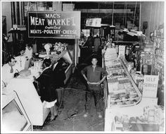 Mac's Meat Market (in the Market House in Annapolis, MD)... Mac Patterson Proprietor... Elwood Jones standing in the aisle...      circa 1955...
