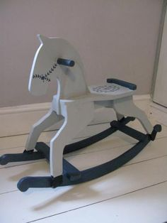 Hand made and hand painted vintage rocking horse. Beautifully understated. For sale now at utoto.co.uk.