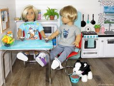 The boys are having some hot chocolate (and kibble) to break in the new kitchen in our American Girl doll house.