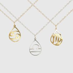kris nations zodiac teardrop necklace is the perfect birthday gift | comes packaged in an adorable glass bottle that shows three traits associated with each sign