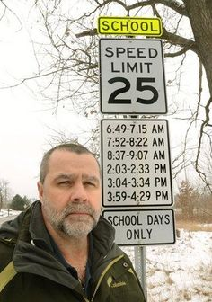 school zone speed sign with times of day when speed limit applies